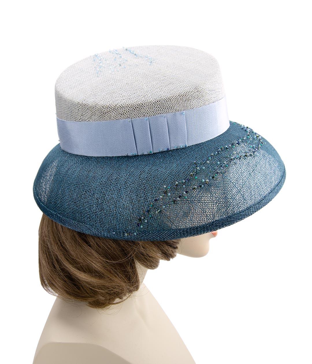 Blue beaded Kentucky Derby hat.