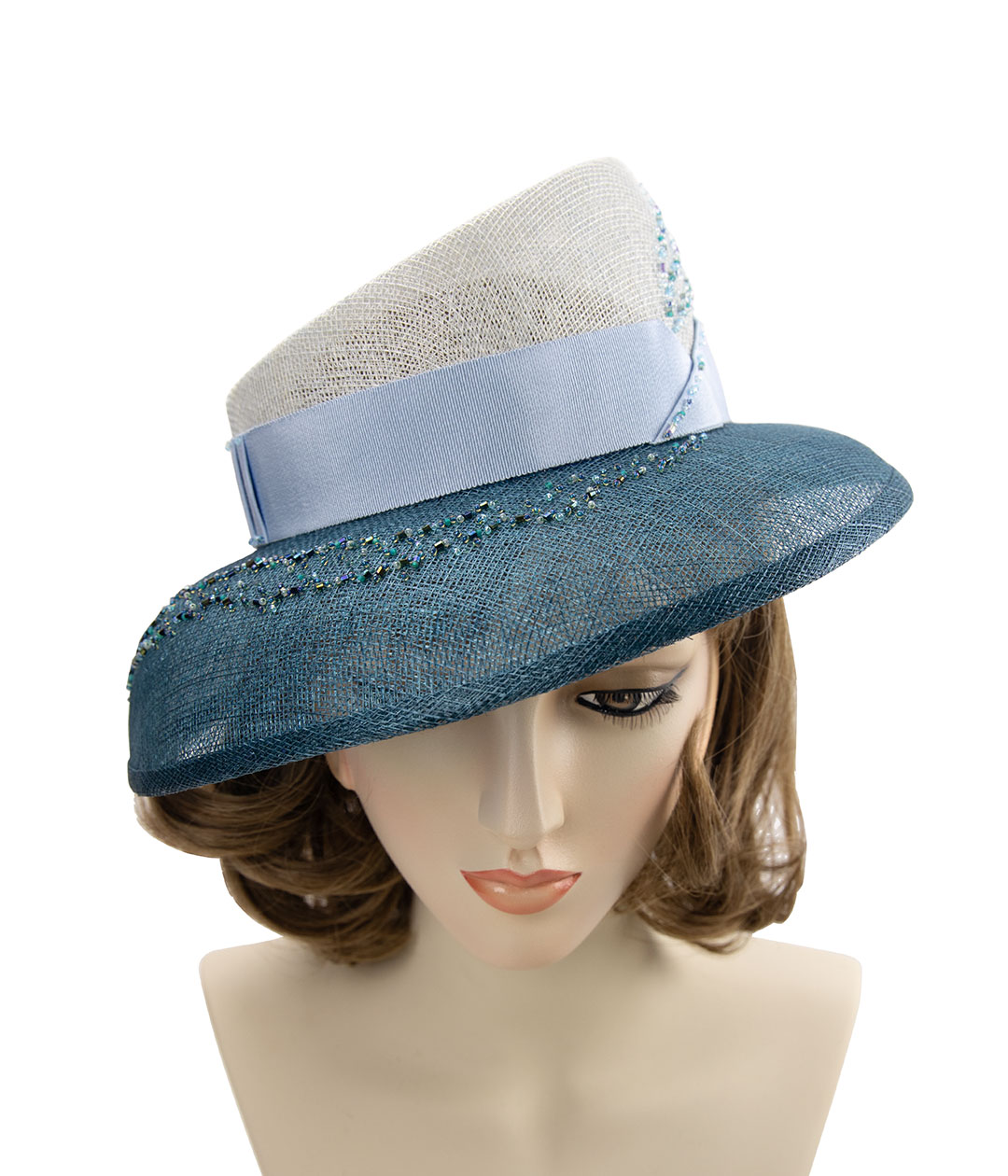 Hand-beaded blue hat in sinamay straw.