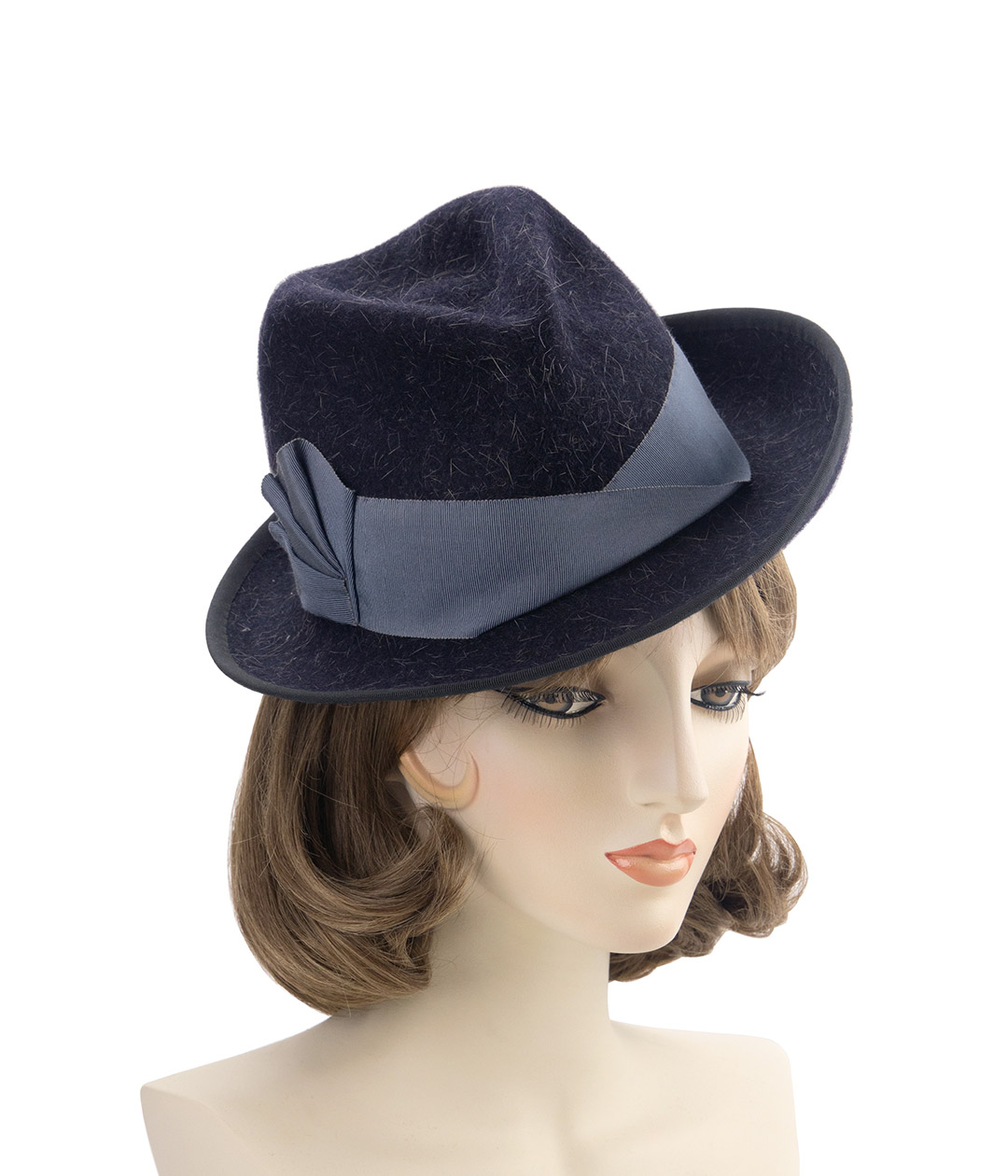 Perching black tilt fedora. Vintage-style hat on a mannequin head.