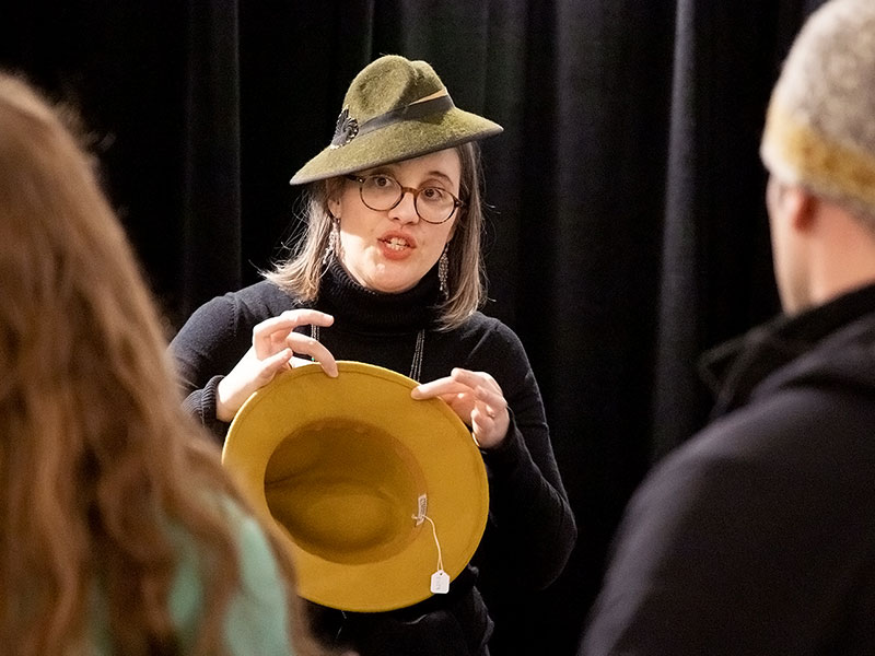 Kristin Silverman displaying a hand-sewn brim edge on a fedora.