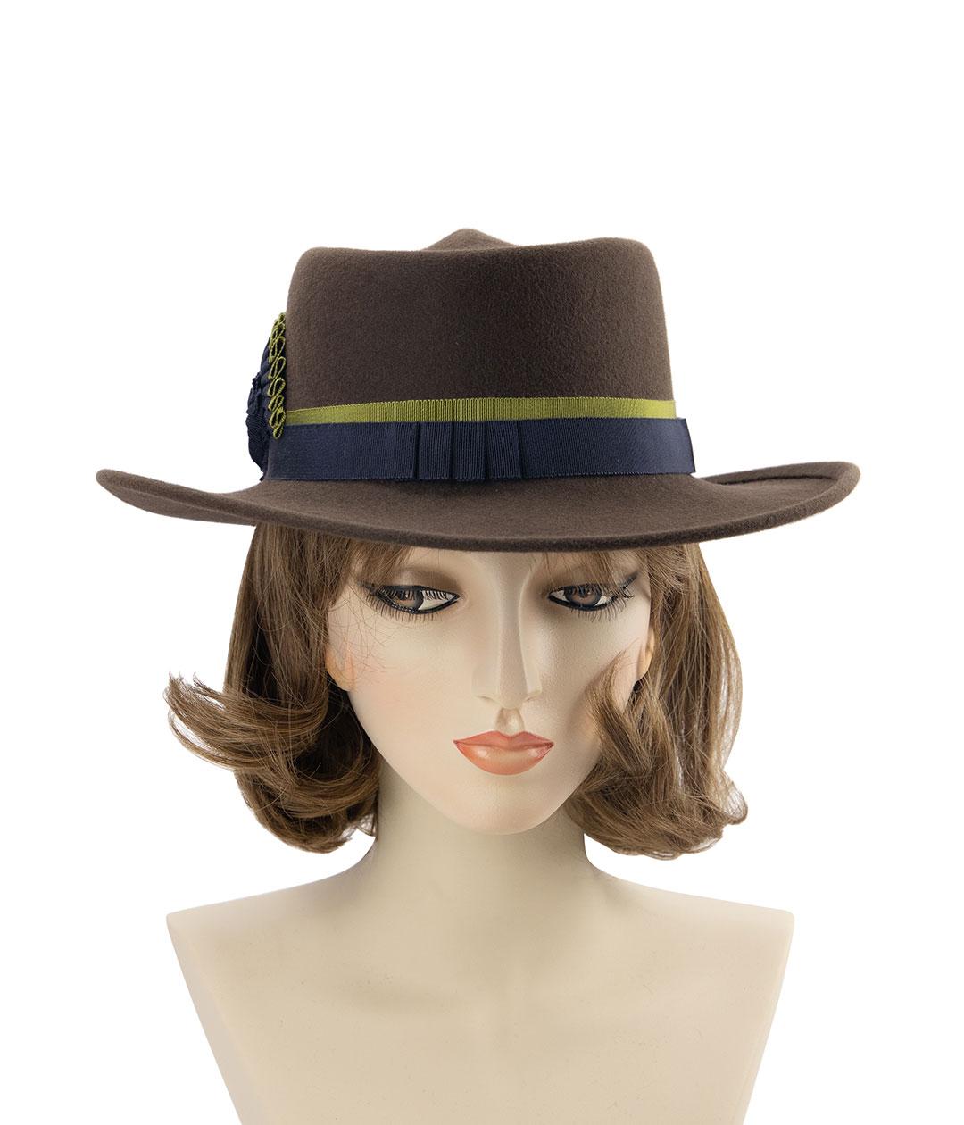 Women's cowboy hat. Brown Western hat front view on mannequin head.