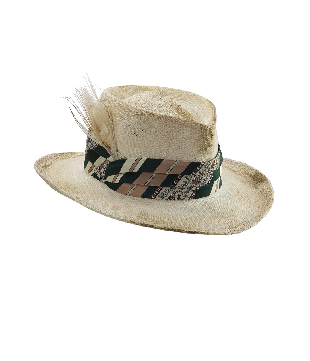 Distressed white straw hat with silk band and bleached peacock feather. Wide-brim Western-style hat on white background.