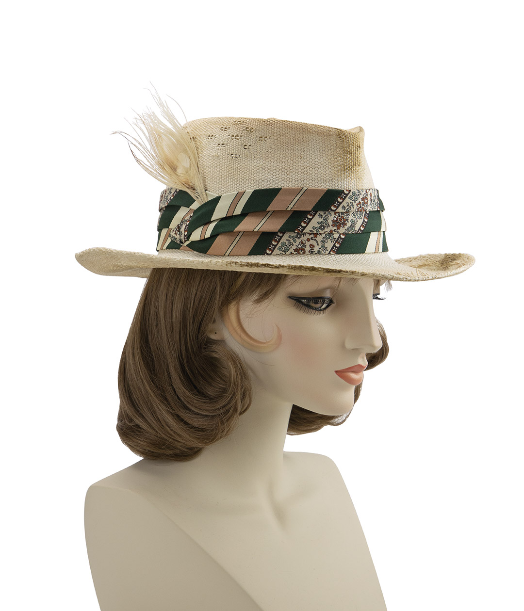 Shabby chic cowboy hat displayed on mannequin head.