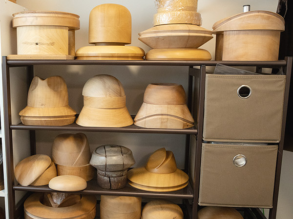 Wood hat blocks on shelves
