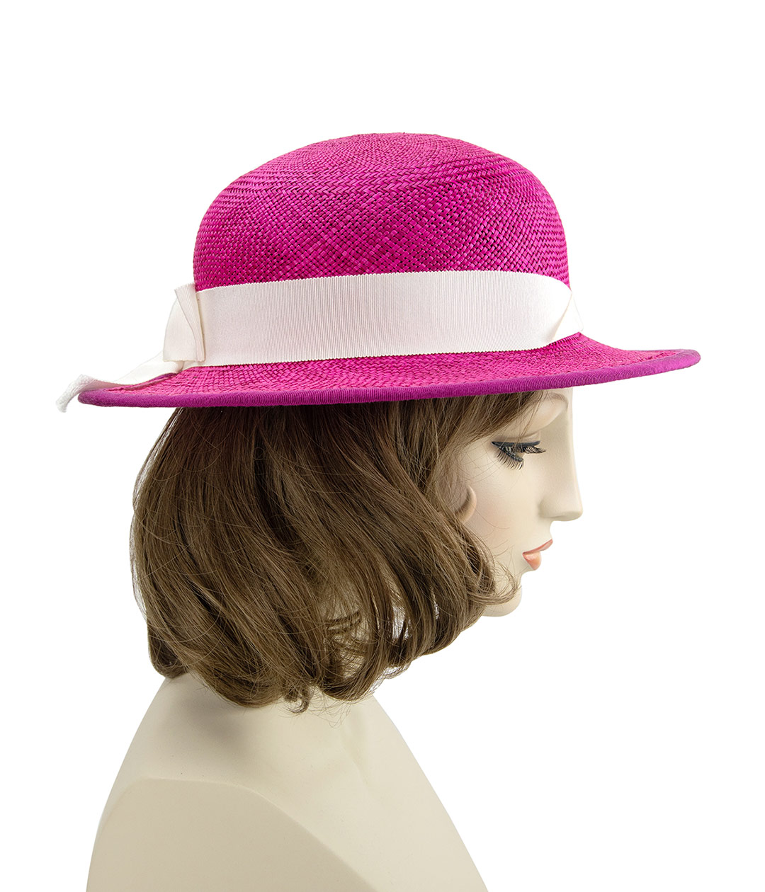 hot pink straw hat on a mannequin head
