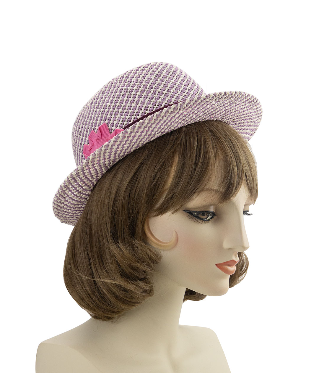 purple straw hat tilted back on the head