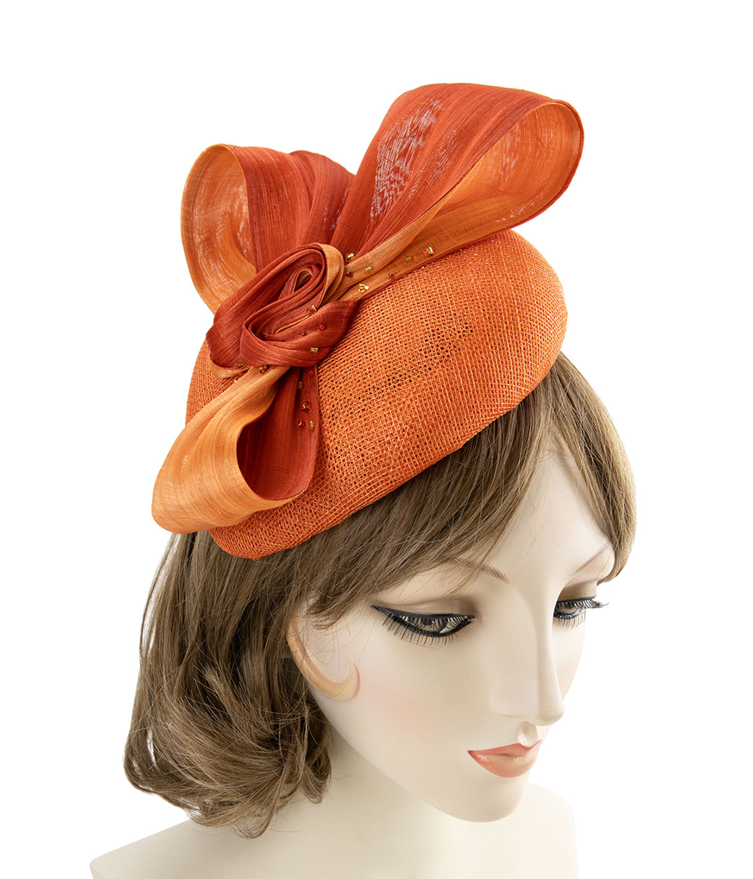 Orange sinamay fascinator with silk abaca bow.