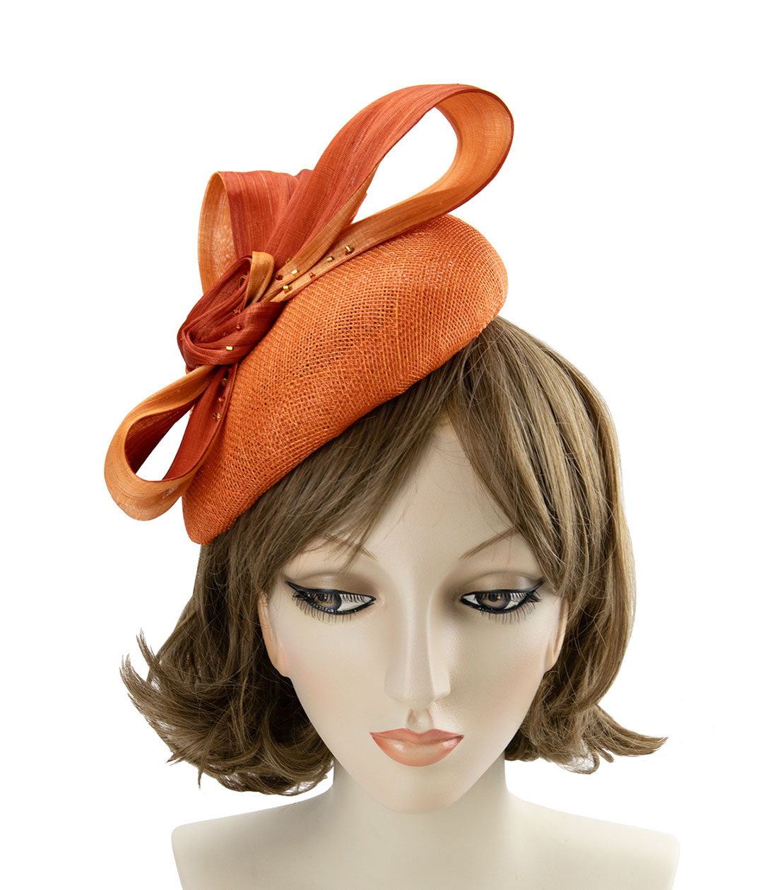 Orange sinamay and silk abaca fascinator, displayed on a mannequin head.