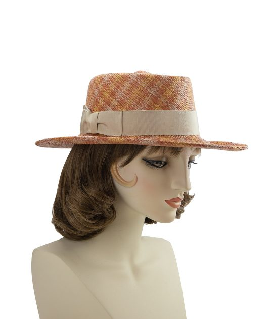 Plaid straw Western-style hat in pastel oranges with a beige band and bow.