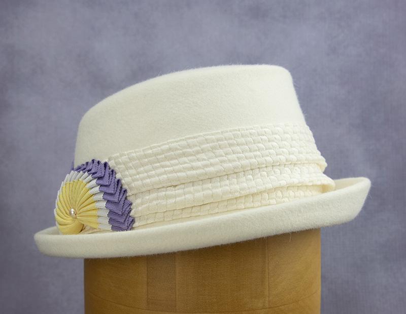 White felt hat with suffragist cockade.