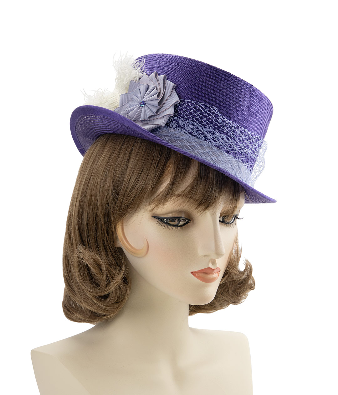 Parasisal straw top hat in purple with periwinkle blue veiling and ribbon cockade.