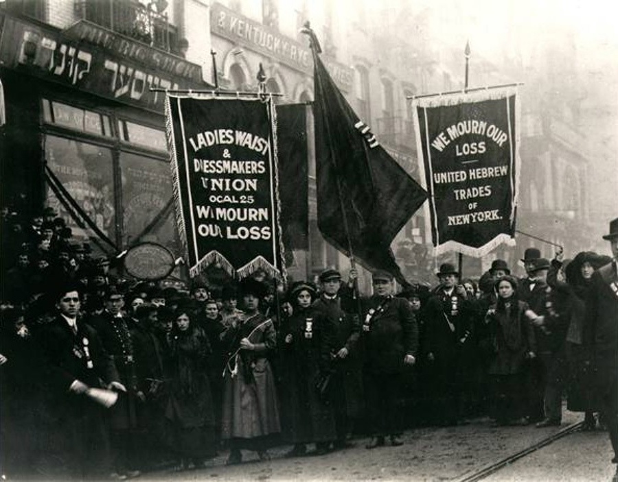 Crowd of mourners with banners after the Triangle Shirtwaist Factory fire.